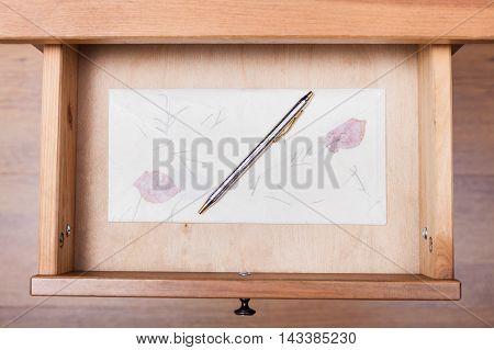 Ballpen On Vintage Envelope In Open Drawer