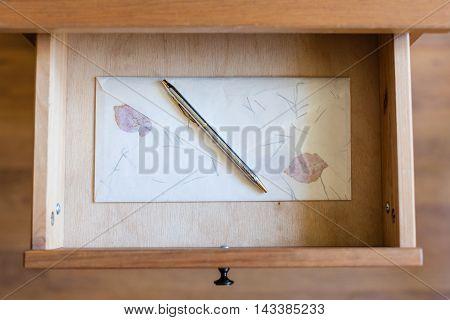 Silver Pen On Vintage Envelope In Open Drawer