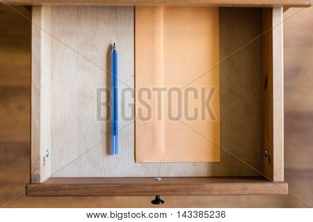 Plastic Pen And Envelope In Open Drawer