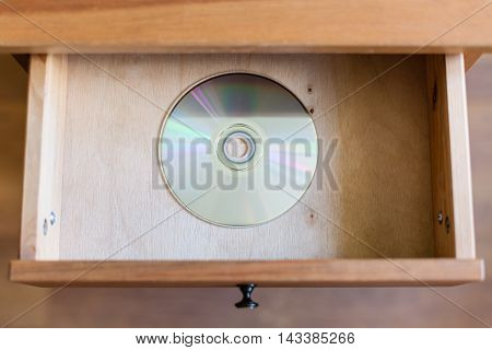 Disk In Open Drawer Of Nightstand