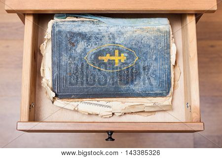 Old Religious Book In Open Drawer