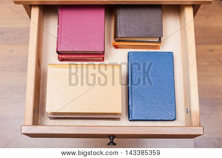 Pack Ofl Little Books In Open Drawer