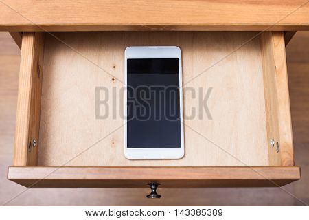Mobile Phone In Open Drawer
