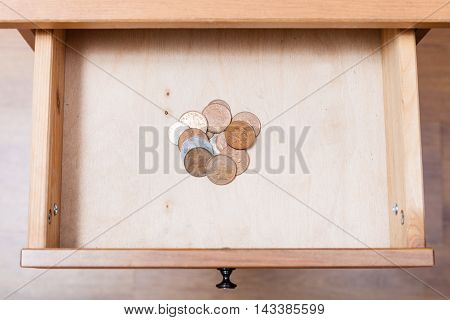 Several Of British Coins In Open Drawer