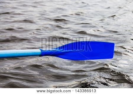 Oar Blade Over The Water During Rowing Boat