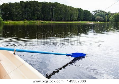 Water Walk On Boat With Oars On City Pond