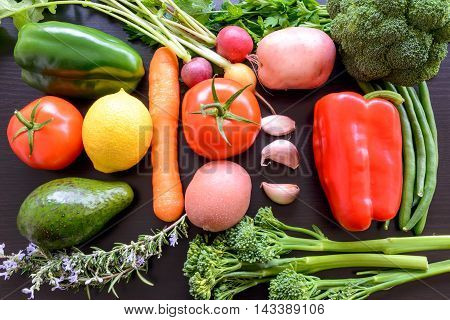 Top flat lay view of fresh organic vegetables on wooden table