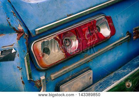 broken broken taillight old blue car in the extended dynamic range