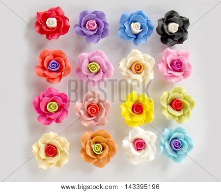 Beautiful polymer clay rose on white background