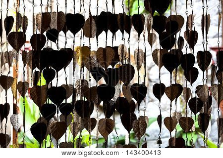 Several golden Pho tree leave are hanging for decoration.Pho silver background and gold.