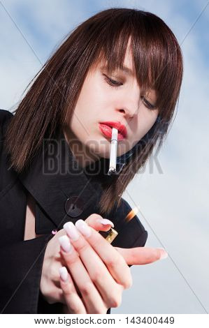 Young Elegant Girl With A Cigarette