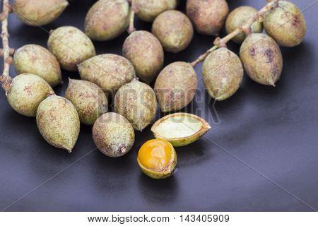 Ceylon oak fruit on black dish (