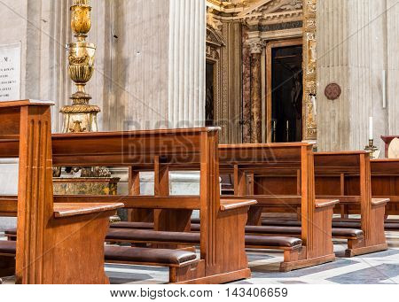 ROME, ITALY - OCTOBER 3, 2016: pews in church