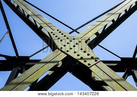 Piece steel assembly bridge. old rail way bridge vintage Metal railway bridge viaduct Lang Suan Chumphon Thailand.