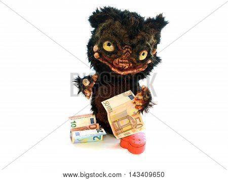 Monster with Euro money and red hearts, hand-made white in the hands of banknote fifty euro
