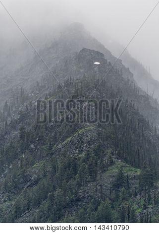 Mountain Gradients climb through thick fog in Montana