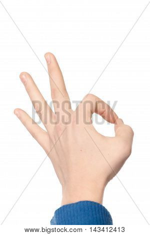 Hand In Blue Sweater Showing Ok Sign Isolated On White