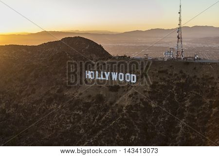Los Angeles, California, USA - July 21, 2016:  Sunset aerial of the Hollywood Sign in Griffith Park with the San Fernando Valley and San Gabriel Mountains in background.