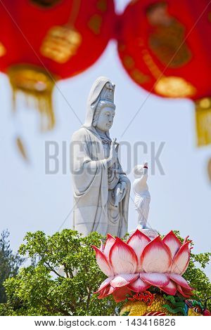 Statue of Guanyin Background sky Place Sathorn in Becket. Guanyin statue The Goddess of Compassion and Mercy.