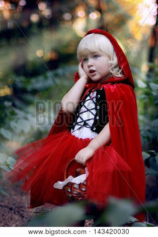 red riding hood little girl funny perplexed thoughtful blonde forest fairy tale
