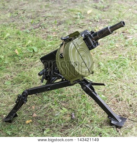automatic grenade launcher on grass with shallow depth of field