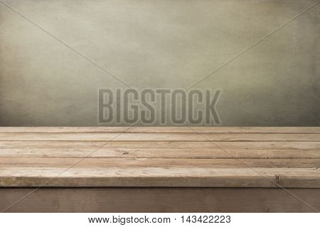 Vintage empty wooden table over grey background