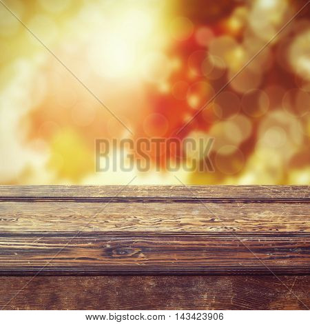 Fall season background with empty wooden table