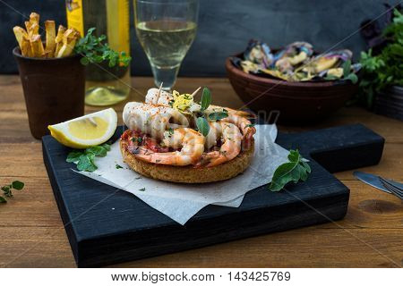 Spanish Tapas with seafood: shrimps and squid.