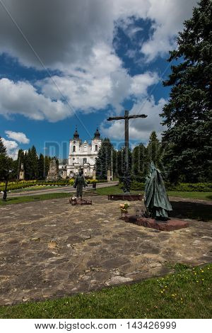 Dukla Poland - July 20 2016: Monument of St. John of Dukla and of St. John Paul II for Shrine of St. John of Dukla in Poland. Bernardine monastery fathers