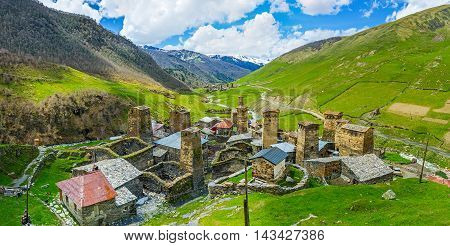 The view from the hill on the medieval picturesque villages of Ushguli community - Chvibiani Chazhashi and Murqmeli located in the narrow Enguri gorge Upper Svaneti Georgia.