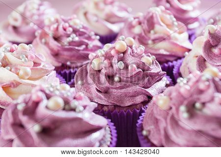 Delicious and sweet cupcakes . They are sequined . Sweets for parties and weddings