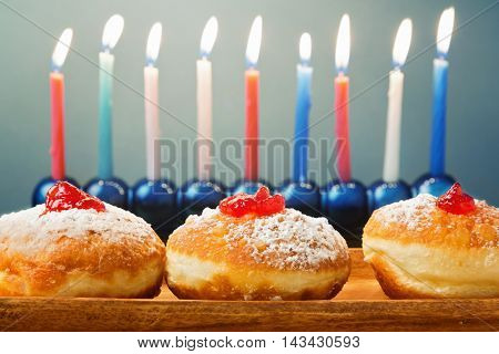 Jewish Holiday Hanukkah background with donuts and lights