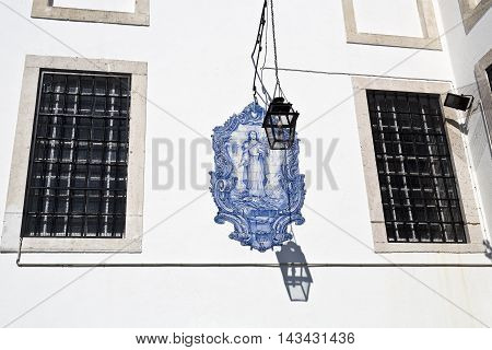 LISBON, PORTUGAL - September 30, 2015: a tile panel with an image of Santa Luzia by an unknown author on the outside wall of the church of Santa Luzia on September 30, 2015 in Lisbon, Portugal