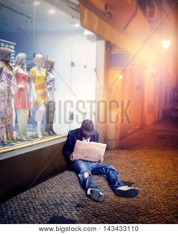 Vagrant sitting near the shop