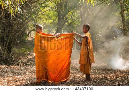 Buddhism neophyte playing little monk life style in temple.