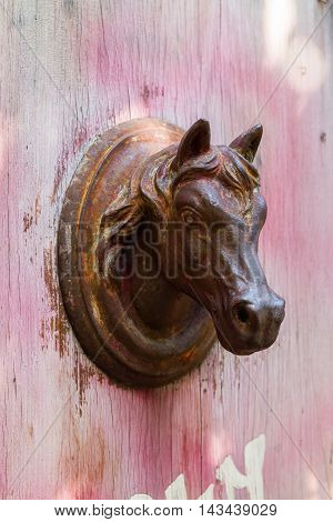 Rusted Horse Head As Doorknob