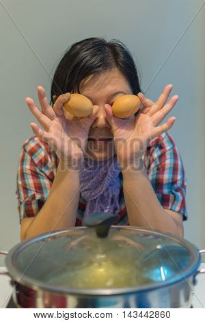 Asia Woman Cooking By Put A Flesh Egg In To A Hot Pot