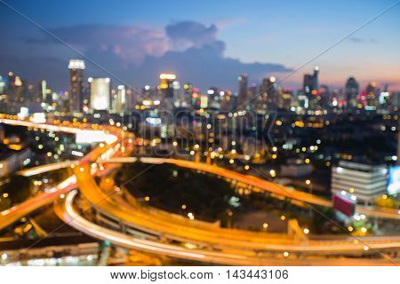 Abstract background, blurred lights city and highway intersection at twilight