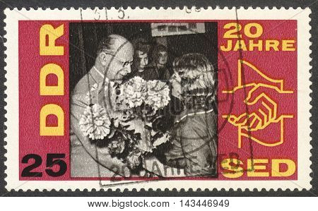 MOSCOW RUSSIA - CIRCA JULY 2016: a stamp printed in DDR shows W. Ulbricht with workers the series