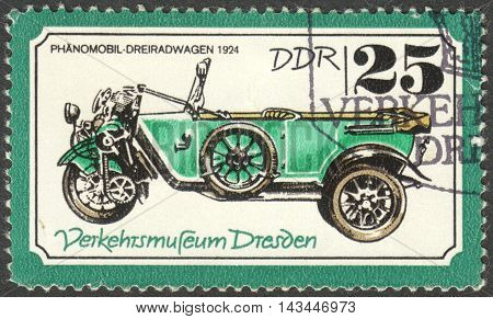 MOSCOW RUSSIA - CIRCA JUNE 2016: a post stamp printed in DDR shows a phanomobil tricycle carriages the series