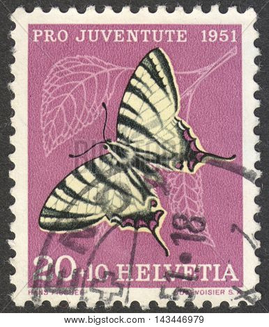 MOSCOW RUSSIA - CIRCA JULY 2016: a post stamp printed in SWITZERLAND shows a butterfly (Iphiclides podalirius) the series
