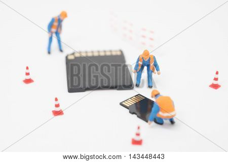 Concept of data recovery. Worker working on micro sd card. poster