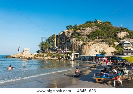 KhaoTakiab Thailand - Dec 26 2015: People enjoing summertime at Khao Takiab Chopstick Hill beach with Calming Buddha statue on the background