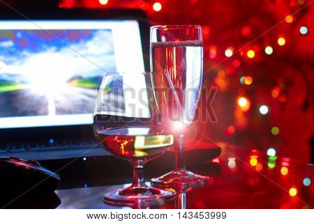 abstract scene with a laptop and two glass goblets