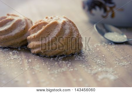 buiscuit with sugar, cup and little spoon