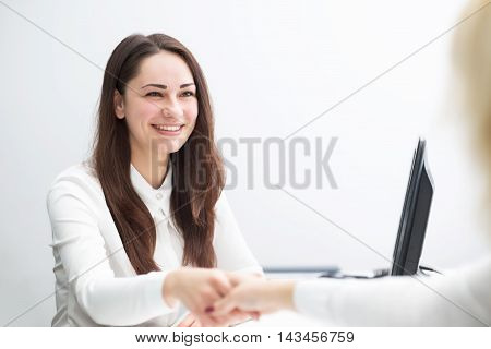 Smiling Business Woman In The Office Concludes Contract