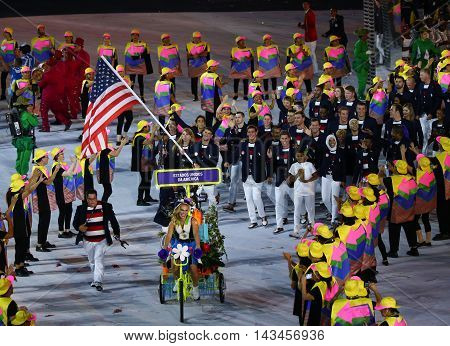 RIO DE JANEIRO, BRAZIL - AUGUST 5, 2016: Olympic champion Michael Phelps carrying the United States flag leading the Olympic team USA in the Rio 2016 Opening Ceremony at Maracana Stadium