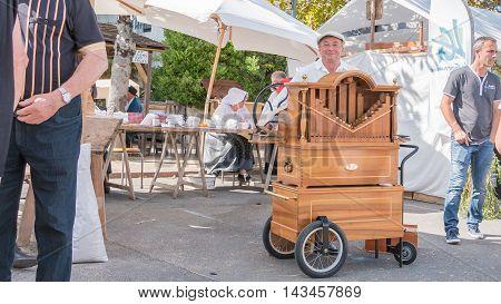 Man Plays The Barrel Organ In The Street