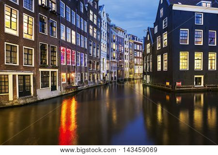 View of famous amsterdam canal at night Netherlands