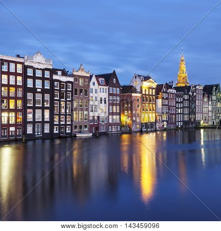 traditional old buildings in Amsterdam by night